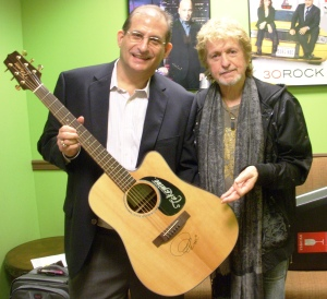 Scott Bluebond (L) and Jon Anderson pose with the signed guitar in the green room of The 10! Show.